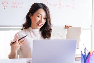 Plakat Asian female teacher teaching online at home