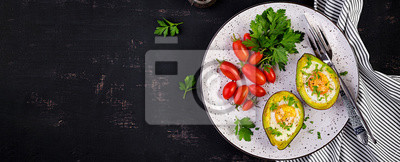 Avocado baked with egg and fresh salad. Vegetarian dish. Top view, overhead.  Ketogenic diet. Banner. Keto food
