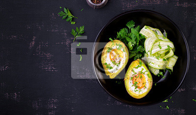 Avocado baked with egg and fresh salad. Vegetarian dish. Top view, overhead.  Ketogenic diet. Keto food