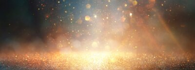 Plakat background of abstract glitter lights. gold, blue and black. de focused