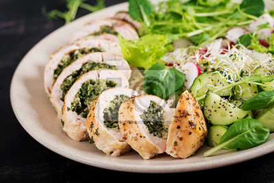 Baked chicken rolls with spinach and cheese on  plate. Healthy lunch. Keto diet.
