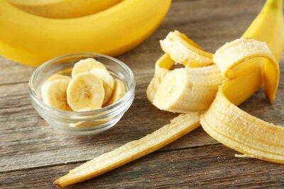 Plakat Banany na szarym tle drewnianych