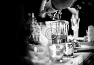 Plakat Bartender making alcohol cocktail at bar counter at nightclub, barman is making cocktail