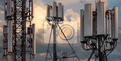 Plakat base stations and mobile phone transmitters against the background of the evening sky