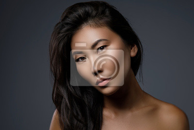 Plakat Beautiful asian woman with a black healthy hair