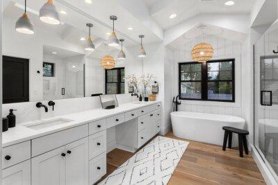 Plakat Beautiful bathroom in luxury home with double vanity, bathtub, mirror, sinks, shower, and hardwood floor