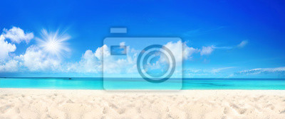 Plakat Beautiful beach with white sand, turquoise ocean water and blue sky with clouds in sunny day. Panoramic view. Natural background for summer vacation.