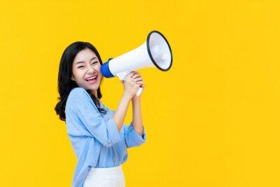 Plakat Beautiful Chinese woman cheerfully using magaphone