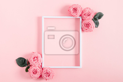 Plakat Beautiful flowers composition. Blank frame for text, pink rose flowers on pastel pink background. Valentines Day, Easter, Birthday, Happy Women's Day, Mother's day. Flat lay, top view, copy space