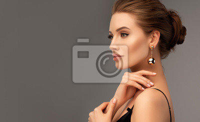 Plakat Beautiful girl . Fashionable and stylish woman in trendy jewelry big earrings .  Fashion look  , beauty and style. Natural makeup & easy styling