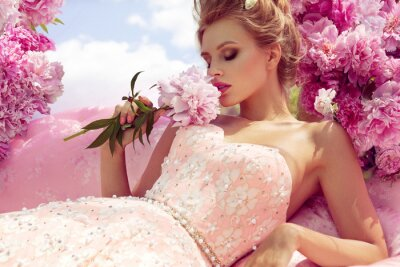 Plakat Beautiful girl in the flower garden in sofa