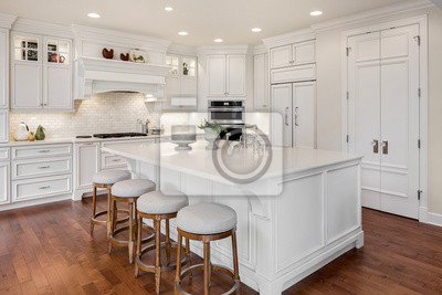 Plakat Beautiful kitchen in new traditional style luxury home, with large island, double ovens, cook top, and open concept floor plan