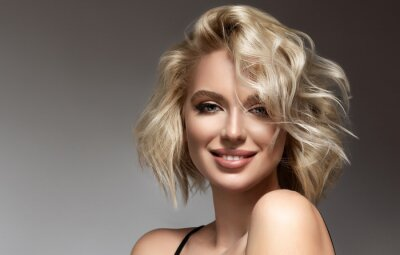 Plakat Beautiful model girl with short hair .Beauty woman with blonde curly hairstyle dye .Fashion, cosmetics and makeup