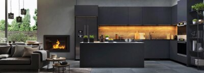 Plakat Beautiful open plan matte black kitchen and dining area with fireplace
