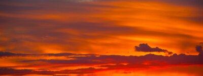 Plakat Beautiful orange clouds in the summer sunset sky