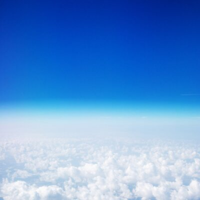 Plakat Beautiful Sky above the clouds. View from the airplane window with blue sky and fluffy clouds