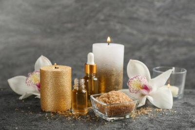 Plakat Beautiful spa composition with essential oil, candles and flowers on grey table