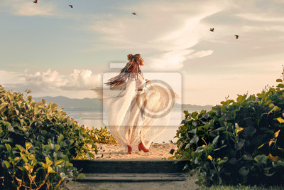 Plakat beautiful young fashion model having fun spinning around at sunset