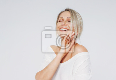 Plakat Beauty portrait of blonde smiling laughing woman 35 year plus clean fresh face with close eyes isolated on white background