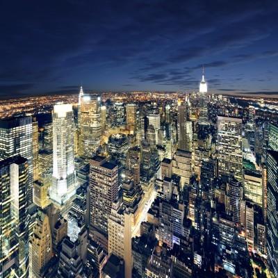 Plakat Big Apple po zachodzie słońca - manhattan Nowy Jork nocą
