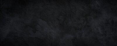 Plakat Black or dark gray rough grainy stone texture background