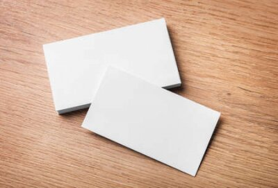 Plakat Blank business cards on wooden background. Top view.