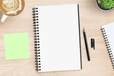 Plakat Blank notebook page is on top of wood office desk table with supplies. Top view, flat lay.