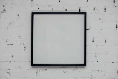 Plakat Blank picture frame at the brick wall