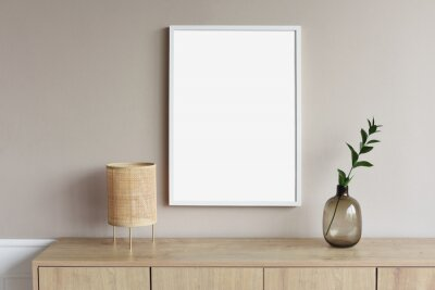 Plakat Blank picture frame mockup on gray wall. White living room design. View of modern scandinavian style interior with artwork mock up on wall. Home staging and minimalism concept