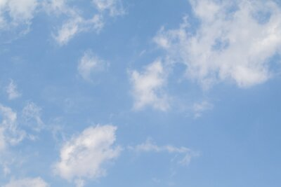 Plakat Blue sky with white clouds. Clear summer day. Perfect desktop wallpaper.