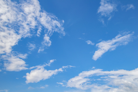 Plakat Blue sky with white clouds from a sunny day. Background image, a place to write text.