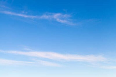 Plakat Blue sky with windy thin clouds at daytime, natural background photo texture