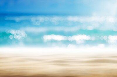 Plakat Blur tropical beach with bokeh sun light wave abstract background.