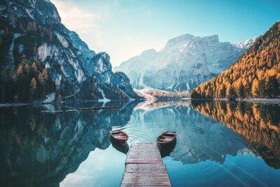 Plakat Boats on the Braies Lake ( Pragser Wildsee ) in Dolomites mountains, Sudtirol, Italy