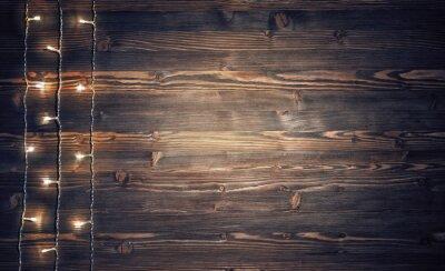 Plakat Boże Narodzenie światła na drewnianych tle.