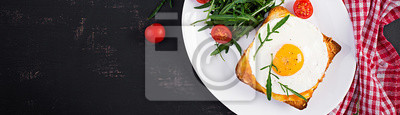 Breakfast. French cuisine. Croque madame sandwich close up on the table. Top view, banner