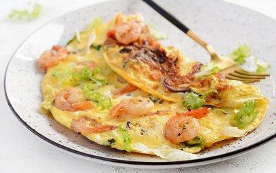 Breakfast. Ketogenic/paleo diet. Omelet with shrimp and herbs. Keto menu. Omelette.