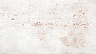 Plakat Brick wall texture with white shabby stucco, plaster. Red  and white brickwall background, white stonewall surface. Plastered wall with white uneven stucco with cracks and damages.