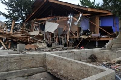 Plakat Brooklyn, NY - 01 listopada: Poważne uszkodzenie w budynkach w sąsiedztwie Seagate od uderzenia huraganu Sandy z Brooklyn, New York, USA, w czwartek, 01 listopada 2012.