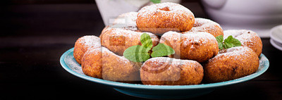 Brunch or lunch. Homemade donuts sprinkled with powdered sugar. Banner