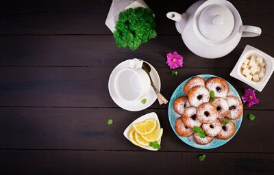 Brunch or lunch. Homemade donuts sprinkled with powdered sugar. Top view