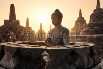 Plakat Buddha statue with the side of the river and the pagodas przy Borobudur świątynią w Yogyakarta, Jawa, Indonezja