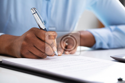 Plakat Businesswoman Filling Contract Form