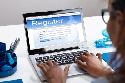 Plakat Businesswoman's Hand Filing Online Registration Form On Laptop