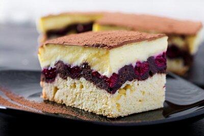 Cake cupcake with cherries, cocoa and custard.