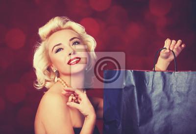 Plakat Całkiem blond dziewczyna jak Marilyn Monroe z torby na zakupy