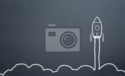 Plakat chalk drawing rocket on blackboard Going up quickly