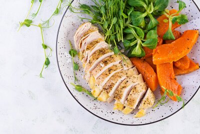 Chicken fillet with baked pumpkin and corn salad. Healthy food, ketogenic diet, diet lunch concept. Keto/Paleo diet menu. Top view, flat lay, copy space