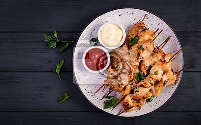 Chicken shish kebab. Shashlik - grilled meat and fresh vegetables. Top view
