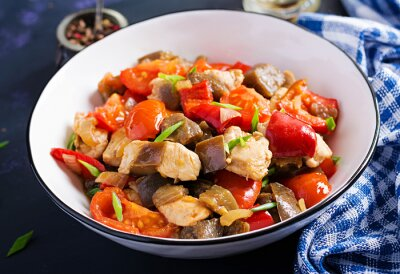 Chicken stir fry. Meat stew with vegetables sweet pepper, onion, tomato, eggplant  in soy sauce gravy. Ketogenic diet.
